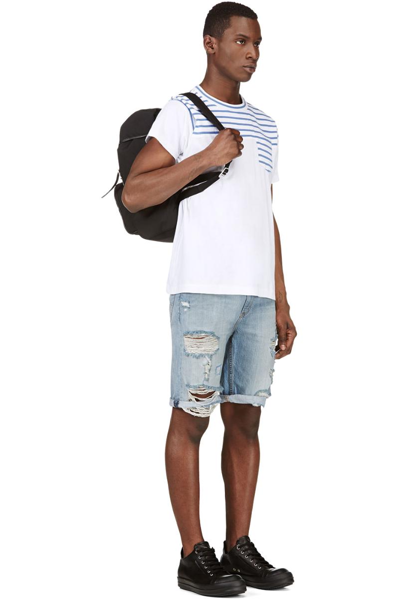 Мужчина в искусственно состаренных джинсовых шортах, Levi's